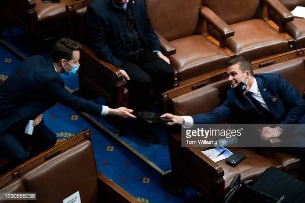 Sen. Josh Hawley, R-Mo., left, and Rep. Madison Cawthorn, R-N.C., attend a joint session of Congress to certify the Electoral College votes of 2020...