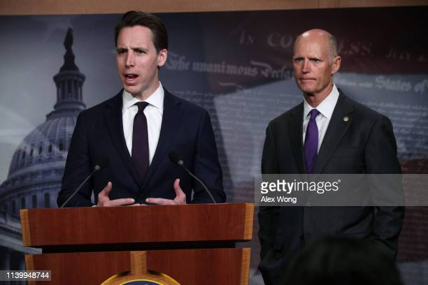 S Sen Josh Hawley speaks as Sen Rick Scott listens during a news conference at the US Capitol April 2 2019 in Washington DC Sen Scott held a news...