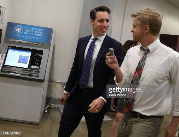 Sen Josh Hawley speaks to a reporter as he makes his way to the Republican policy luncheon on Capitol Hill May 07 2019 in Washington DC