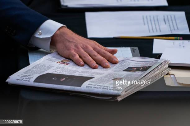 Sen. Joshua Hawley points out a newspaper article regarding Supreme Court nominee Judge Amy Coney Barrett before the Senate Judiciary Committee on...