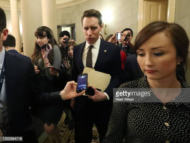 Sen Joshua Hawley walks out of a Senate GOP caucus meeting after President Donald Trump's impeachment trial ended for the day at the US Capitol on...