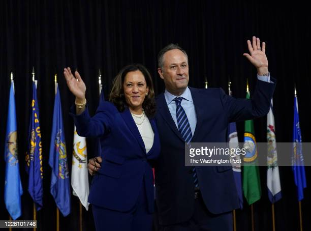 Sen. Kamala D. Harris and her husband Doug Emhoff wave after Harris was introduced by presumptive Democratic presidential nominee Joe Biden as his...