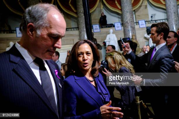 S Sen Kamala Harris confers with Sen Bob Casey as they makes their way to the House of Representatives Chamber for President Donald Trump's first...