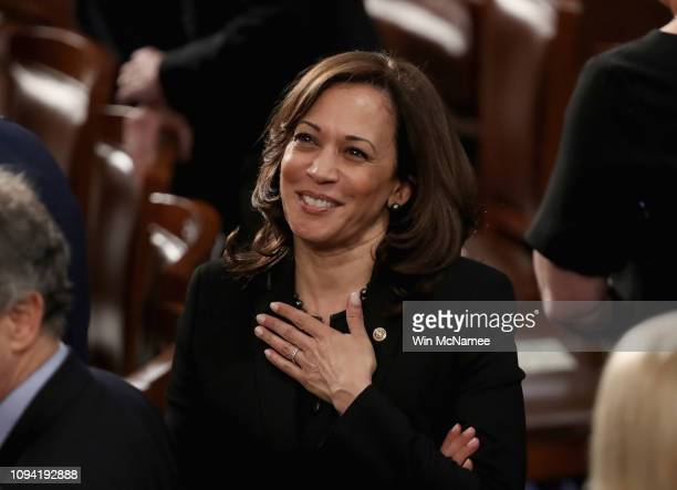Sen. Kamala Harris greets fellow lawmakers ahead of the State of the Union address in the chamber of the U.S. House of Representatives on February 5,...