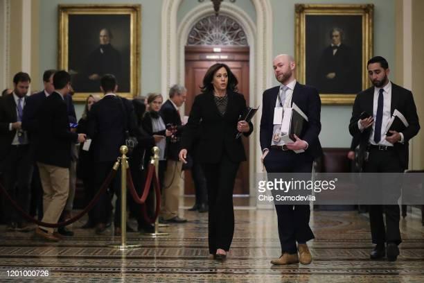 Sen. Kamala Harris heads toward the Senate Chamber before the start of President Donald Trump's impeachment trial at the U.S. Capitol January 21,...