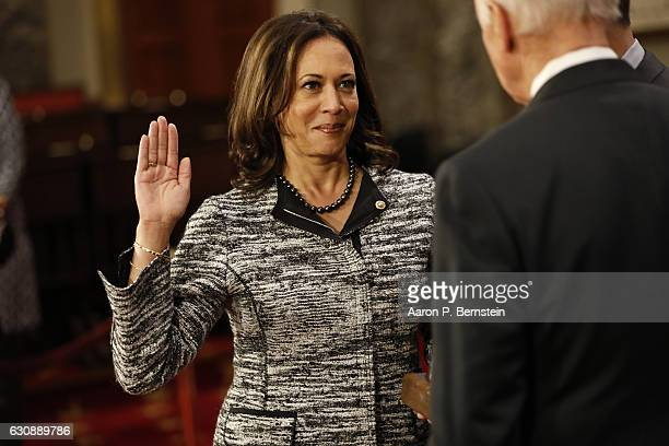 Sen. Kamala Harris participates in a reenacted swearing-in with U.S. Vice President Joe Biden in the Old Senate Chamber at the U.S. Capitol January...