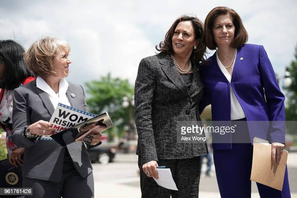 S Sen Kamala Harris shares a moment with Sen Catherine Cortez Masto as Rep Michelle Lujan Grisham looks on during a news conference on immigration in...