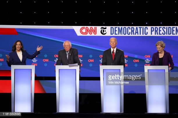 Sen. Kamala Harris speaks as Sen. Bernie Sanders , former Vice President Joe Biden, and Sen. Elizabeth Warren look on during the Democratic...