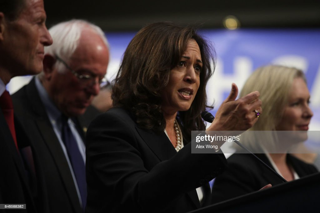 U.S. Sen. Kamala Harris (D-CA) (C) speaks on health care as Sen. Bernie Sanders (I-VT) (2nd L) listens during an event September 13, 2017 on Capitol Hill in Washington, DC. Sen. Sanders held an event to introduce the Medicare for All Act of 2017.