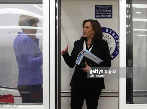 Sen Kamala Harris talks with Sen Tammy Baldwin in the Senate subway after the Senate voted to overturn the President's national emergency border...