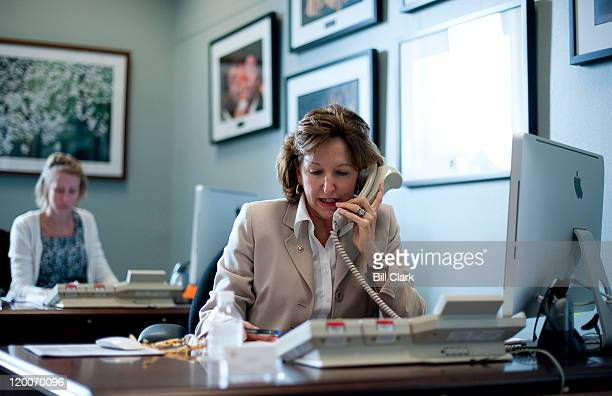 Sen Kay Hagan DNC sits at a desk in the lobby of her Dirksen office as she speaks with constituents who have called her office to voice their opinion...