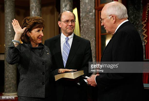 S Sen Kay Hagan poses for photographers with her husband Chip and Vice President Dick Cheney during a mock swearingin ceremony on Capitol Hill...