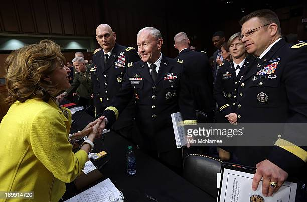 Sen Kay Hagan shakes hands with Chairman of the Joint Chiefs of Staff Gen Martin Dempsey following testimony with US military leaders before the...