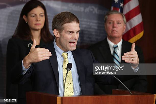 Sen Kelly Ayotte Rep Jim Jordan and Sen Lindsey Graham hold a news conference about Benghazi at the US Capitol October 30 2013 in Washington DC...