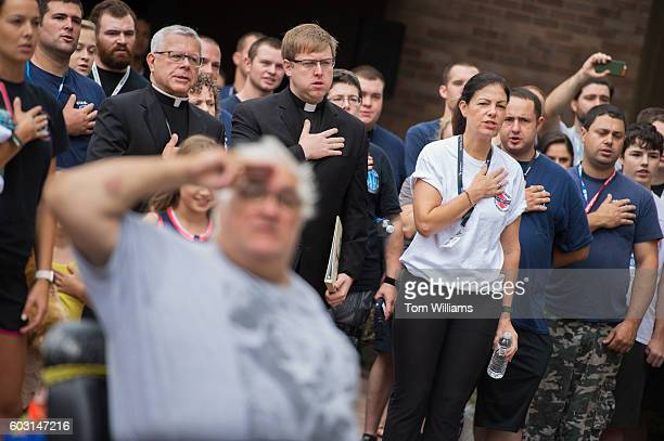 Sen Kelly Ayotte RNH right attends the 9/11 Memorial Stair Climb in the Brady Sullivan Building in Manchester NH September 11 2016 Participants climb...