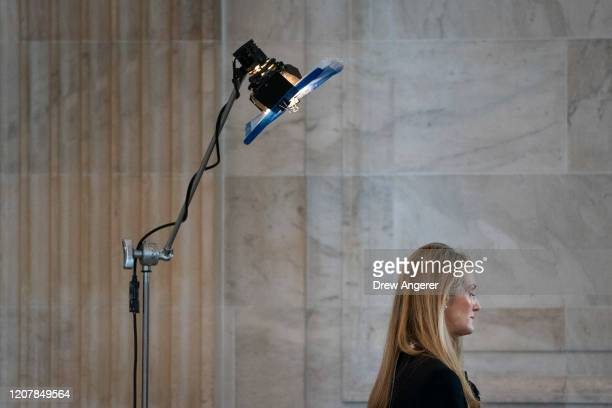 Sen. Kelly Loeffler does a television interview after a Senate GOP lunch meeting in the Russell Senate Office Building on Capitol Hill March 20, 2020...
