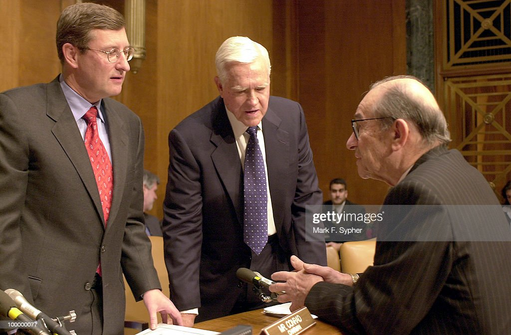Sen. Kent Conrad (D-ND), ranking Budget Committee Chair, left, and Sen. Ernest F. Hollings (D-SC), center, get down to business with Alan Greenspan, right, of the Board of Govenors, Federal Reserve System, during Greenspan's 18th appearance before the Senate's Budget Committee on Thursday.