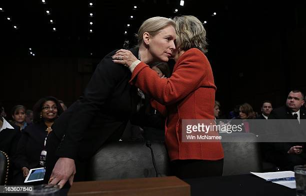 S Sen Kirsten Gillibrand confers with US Sen Barbara Boxer before a hearing on sexual assaults in the miitary March 13 2013 in Washington DC The...