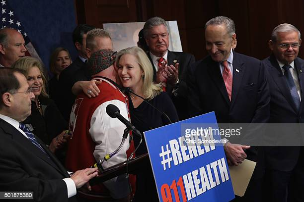 Sen Kirsten Gillibrand embraces FealGood Foundation cofounder John Feal during a news conference with Rep Jerrold Nadler Rep Carolyn Maloney Sen...