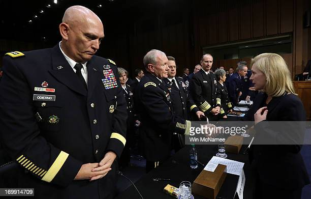 Sen Kirsten Gillibrand shakes hands with Chairman of the Joint Chiefs of Staff Gen Martin Dempsey as Chief of Staff of the Army Gen Raymond Odierno...