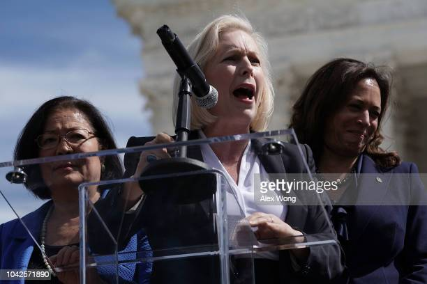 S Sen Kirsten Gillibrand speaks as Sen Mazie Hirono and Sen Kamala Harris listen during a rally in front of the US Supreme Court September 28 2018 in...