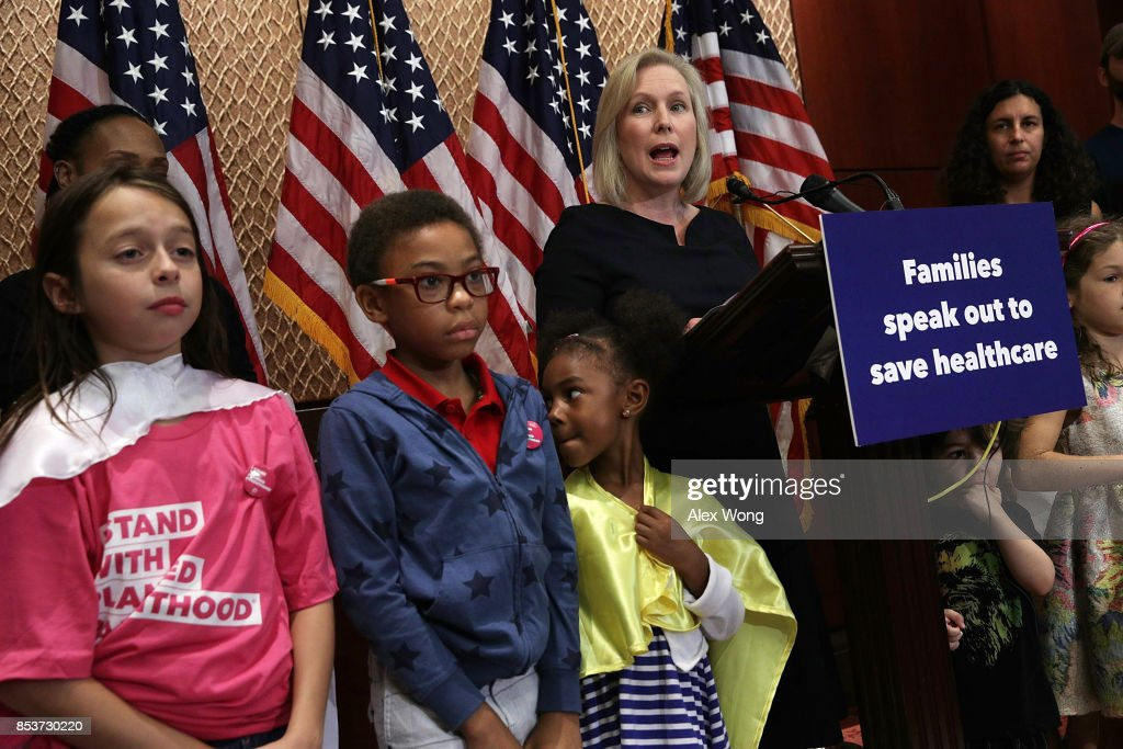 U.S. Sen. Kirsten Gillibrand (D-NY) (4th L) speaks during a news conference on health care September 25, 2017 on Capitol Hill in Washington, DC. Activists gathered to urge to reject the Graham-Cassidy health care bill.