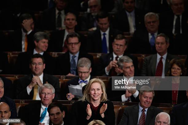 S Sen Kristen Gillibrand claps as US President Barack Obama delivers the State of the Union address to a joint session of Congress in the House...