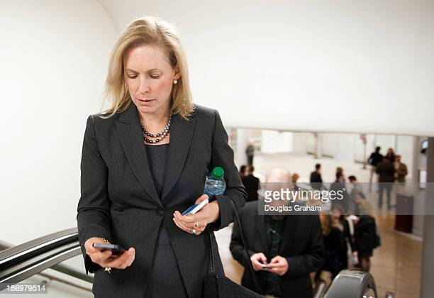 Sen Kristen Gillibrand DNY checks her phone as she walks to the Senate luncheons through the subway in the US Capitol on November 5 2013