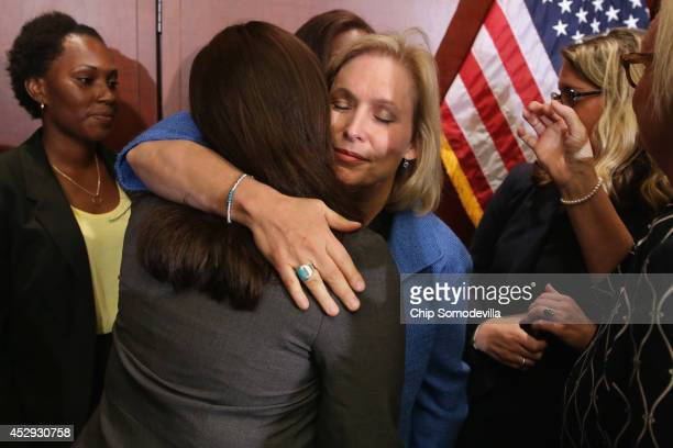 Sen Kristen Gillibrand embraces End Rape on Campus cofounder Andrea Pino a survivor of sexual assult at the University of North Carolina during a...