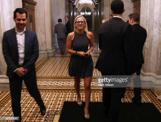 Sen Kyrsten Sinema departs after the Senate voted on the budget agreement at the US Capitol on August 1 2019 in Washington DC The Senate passed a two...