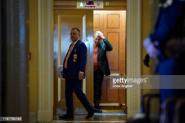 Sen Lamar Alexander gets into an elevator outside the Senate chamber as the Senate impeachment trial of US President Donald Trump continues at the US...