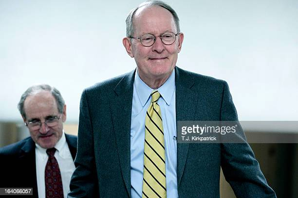 S Sen Lamar Alexander heads to the weekly Senate Republicans policy luncheon on March 19 2013 in Washington DC The Senate is expected to pass a...