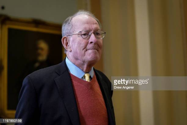 Sen Lamar Alexander leaves the Senate chamber during a recess in the Senate impeachment trial of US President Donald Trump at the US Capitol on...