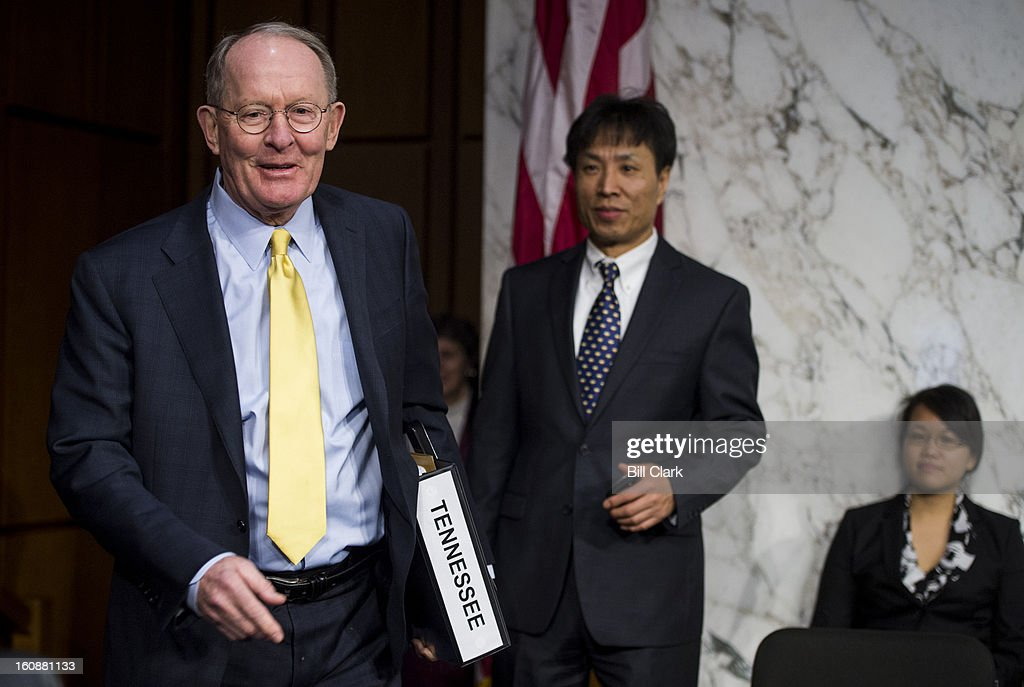 Sen. Lamar Alexander, R-Tenn., left, takes his seat before the start of the Senate Health, Education, Labor and Pensions Committee hearing on 'No Child Left Behind: Early Lessons from State Flexibility Waivers' on Thursday, Feb. 7, 2013.