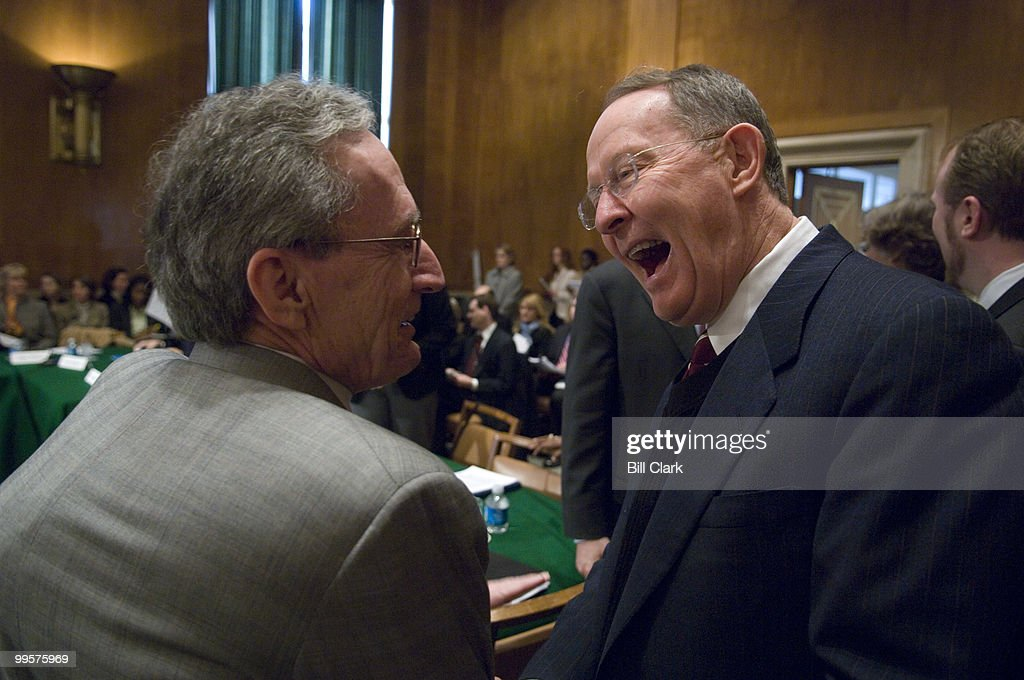 Sen. Lamar Alexander, R-Tenn., right, greets Dr. William Sanders, Senior Manager at the SAS Institute in Cary, N.C., before the start of the Senate Committee on Health, Education, Labor, and Pensions hearing on No Child Left Behind on Tuesday, March 6, 2007.