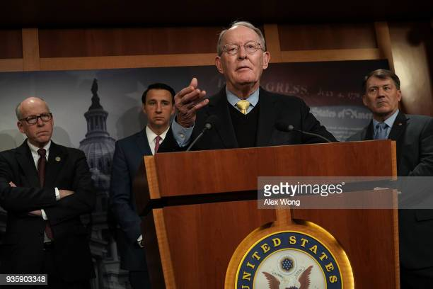 S Sen Lamar Alexander speaks as Rep Greg Walden Rep Ryan Costello and Sen Mike Rounds listen during a news conference at the Capitol March 21 2018 in...