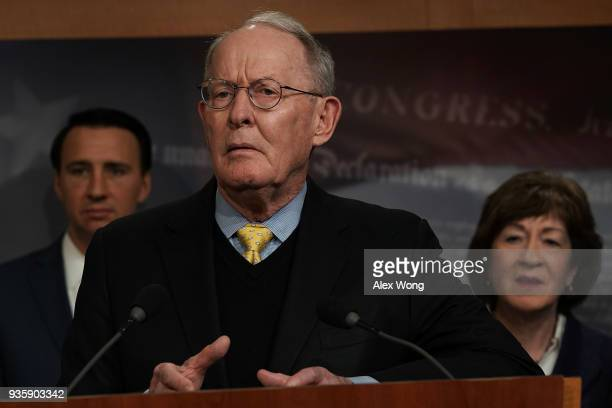S Sen Lamar Alexander speaks as Rep Ryan Costello and Sen Susan Collins listen during a news conference at the Capitol March 21 2018 in Washington DC...