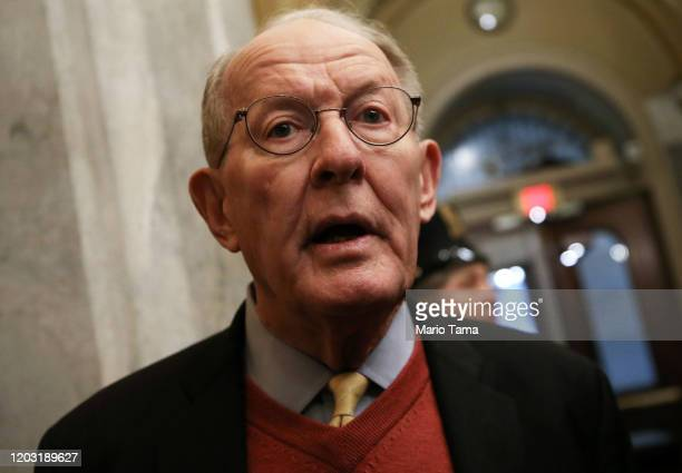 Sen Lamar Alexander speaks to reporters as he arrives at the US Capitol as the Senate impeachment trial of US President Donald Trump continues on...