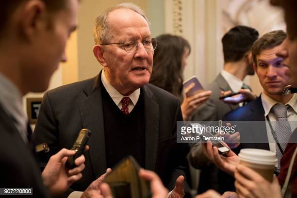 Sen Lamar Alexander speaks with reporters at the US Capitol January 19 2018 in Washington DC A continuing resolution to fund the government has...
