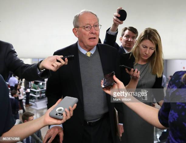 Sen Lamar Alexander talks to reporters as he walks to the Senate chamber for a series of 6 roll call votes regarding the Fiscal Year 2018 Budget...