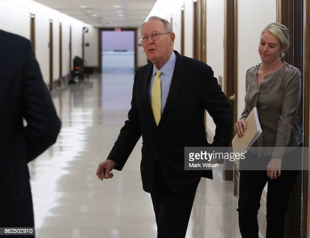 Sen Lamar Alexander walks out of his office to speak to the media about a possible bipartisan agreement with Democrats to fund key Affordable Care...