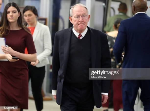 Sen Lamar Alexander walks through the US Capitol prior to the Senate voting to overturn the President's national emergency border declaration at the...