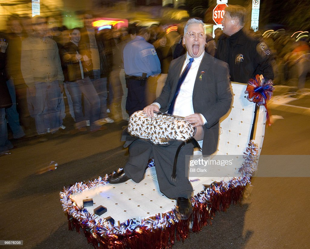 Sen. Larry Craig sits on a toilet pushed by a Minneapolis Airport Police officer on 17th St. NW before the annual High Heel Race on Tuesday night, Oct. 30, 2007. Craig was played by Shannon Kirby of Washington. The officer is Max Kirby, also of Washington.