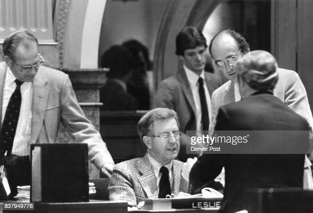 Sen Les Fowler is surrounded by other senators after he told them to not voter for his hot tub bill L to R Sen Dan Noble Sgt at arms Sen Tillie...