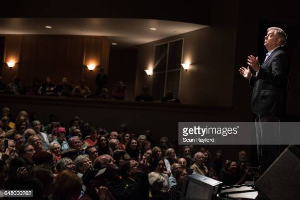 Sen Lindsey Graham addresses the crowd during a town hall meeting March 4 2017 in Clemson South Carolina Protestors have been showing up in large...