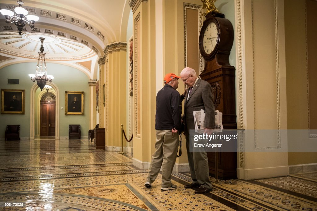 Sen. Lindsey Graham (R-SC) and Sen. Patrick Leahy (D-VT) talk to each other outside the Senate floor on Capitol Hill, January 21, 2018 in Washington, DC. Lawmakers are convening for a Sunday session to try to resolve the government shutdown.