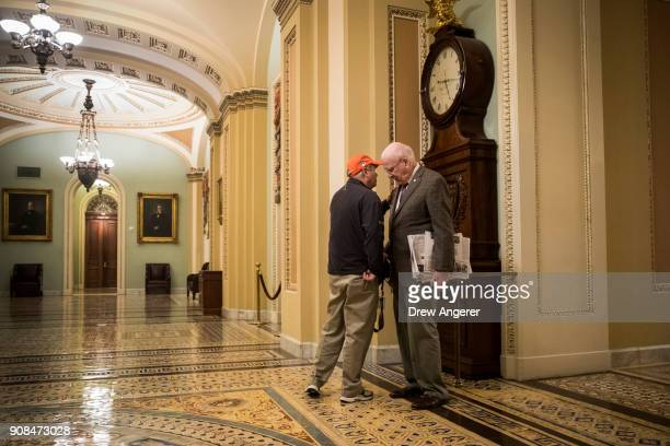 Sen Lindsey Graham and Sen Patrick Leahy talk to each other outside the Senate floor on Capitol Hill January 21 2018 in Washington DC Lawmakers are...