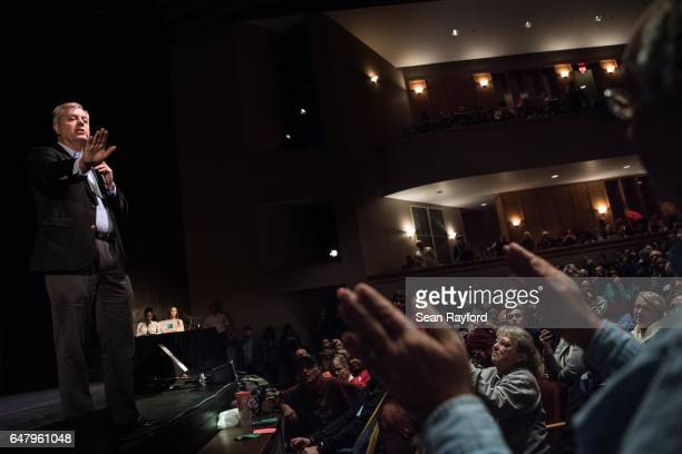 Sen Lindsey Graham answers a question from the crowd during a town hall meeting March 4 2017 in Clemson South Carolina Protestors have been showing...