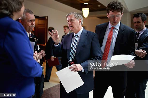 Sen Lindsey Graham arrives at a news conference to introduce new legislation the PainCapable Unborn Child Protection Act at the US Capitol November 7...