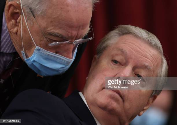 Sen. Lindsey Graham , Chairman of the Senate Judiciary Committee, speaks with Sen. Chuck Grassley prior to a committee hearing on September 24, 2020...